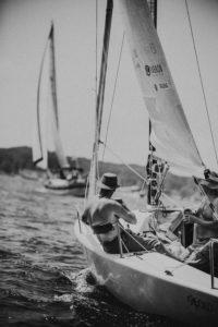 Gentleman enjoying a beverage while sailboating