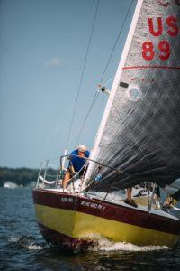 Close up of man sailing sailboat