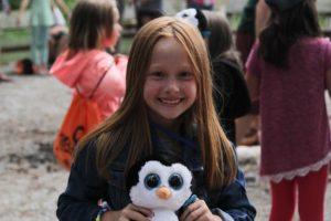 girl with stuffed penguin